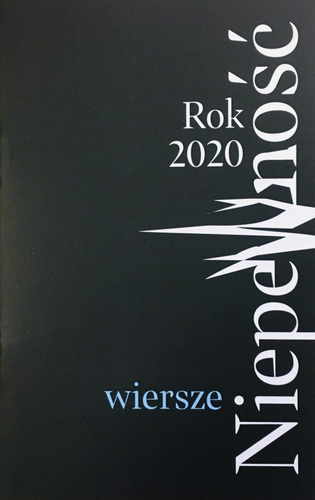 czarna okładka książki z białym tytułem